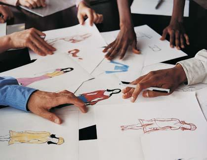 Designers working on designs for fashion week
