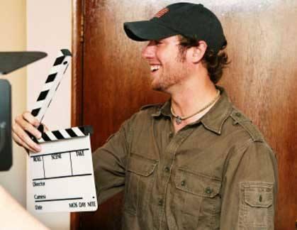 clapperboard operator on film set