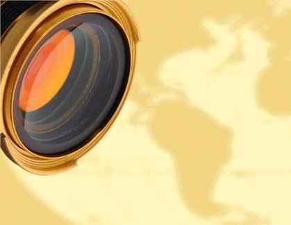 film camera lens superimposed over map of world