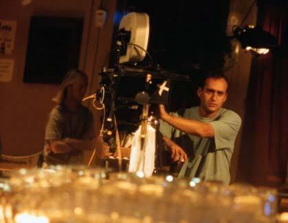 A film school grad mans the camera during an indoor scene